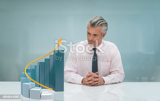istock Business man looking at a 3D growth graph 494644582