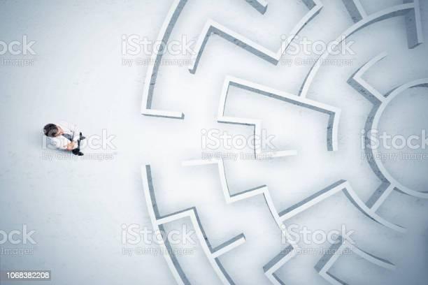 Business man looking at circular maze with nowhere to go picture id1068382208?b=1&k=6&m=1068382208&s=612x612&h=yd6febp1bsrtgv0bvdftt5q72e6lsxqgtsyoyi6cwbi=