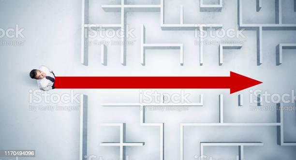 Business man looking at maze with red arrow picture id1170494096?b=1&k=6&m=1170494096&s=612x612&h= 5cmfhpm7amgek6b6exxgvusvphdjvrioarri6skoo8=