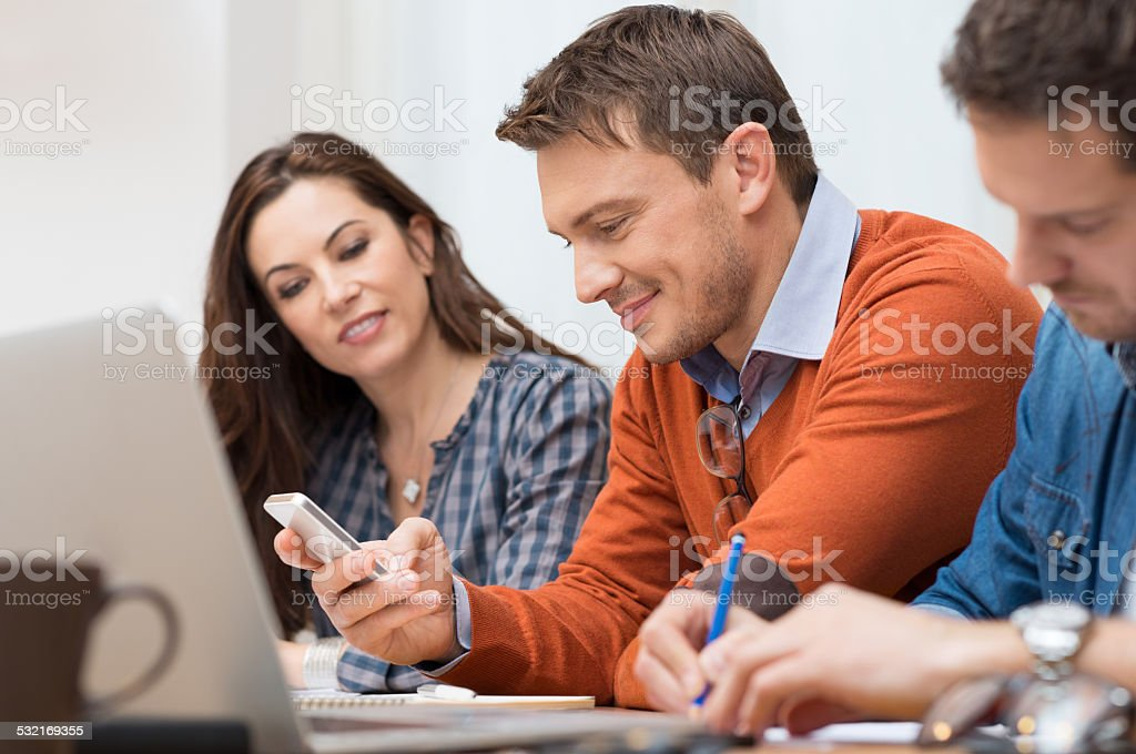 Business man looking at phone stock photo