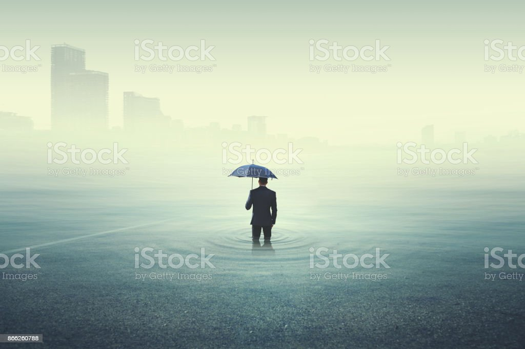 business man looking at the city underwater stock photo