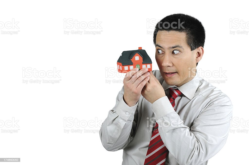 Business Man looking into small House stock photo