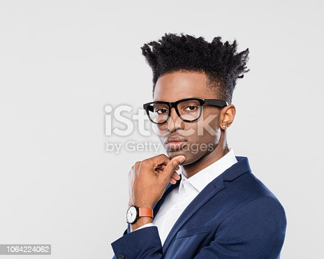 611876426 istock photo Business man looking serious on white background 1064224062