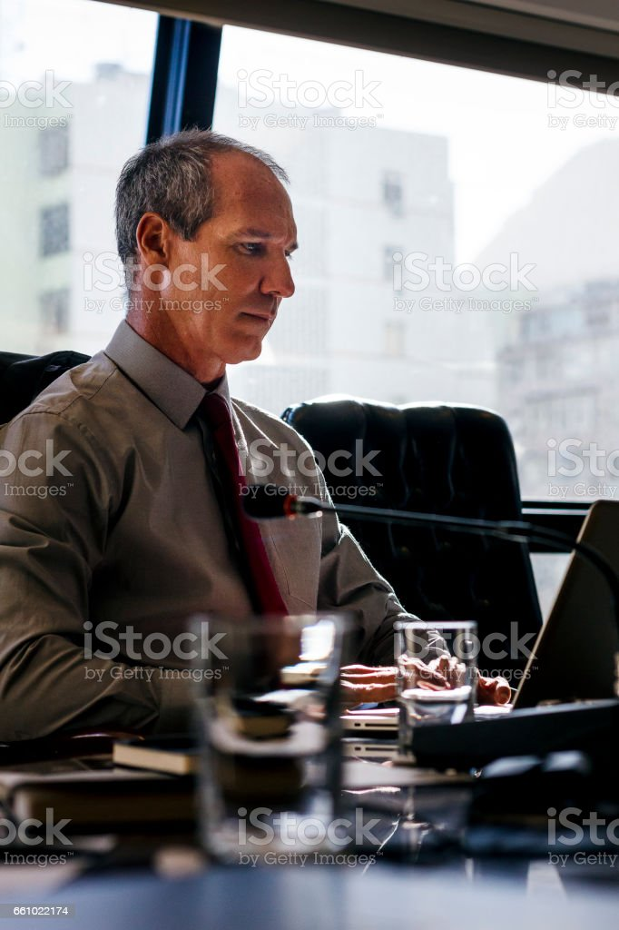 Business man looking seriously working on a conference room stock photo
