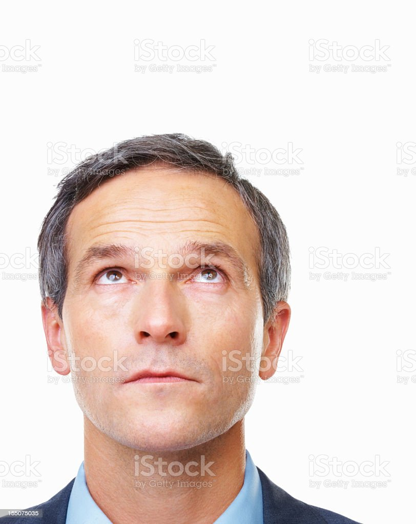 A business man looking up thoughtfully  royalty-free stock photo