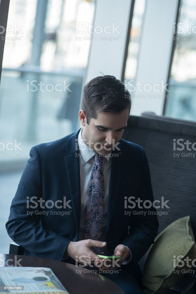 Business Man Making A Contactless Payment On Smart Device stock photo