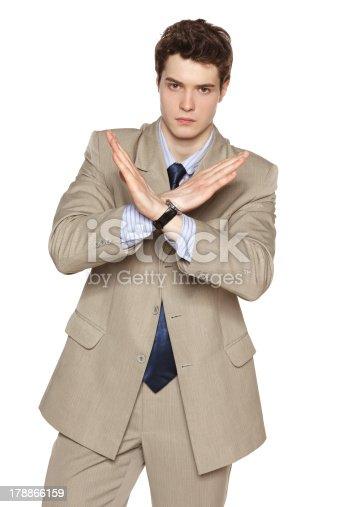 Young business man making stop gesture against white background