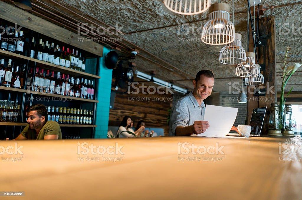 Business man managing a restaurant stock photo