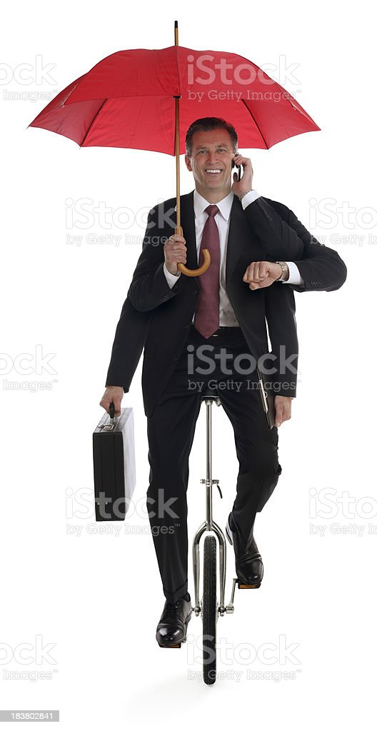 Business Man Multitasking on a Unicycle stock photo