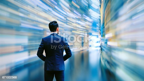 Business man observing fast speed dataflow.