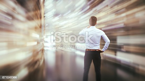 istock Business man observing fast speed dataflow 671045366