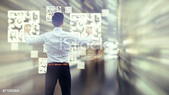 istock Business man observing fast speed dataflow 671053300