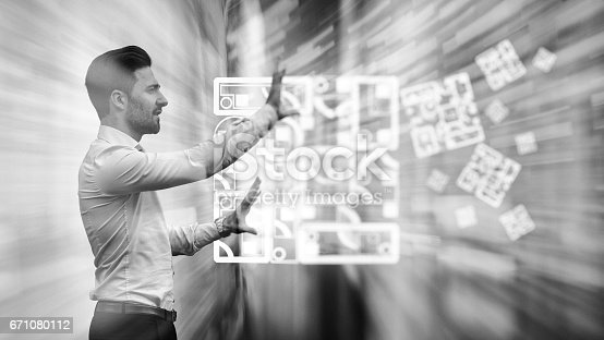istock Business man observing fast speed dataflow 671080112