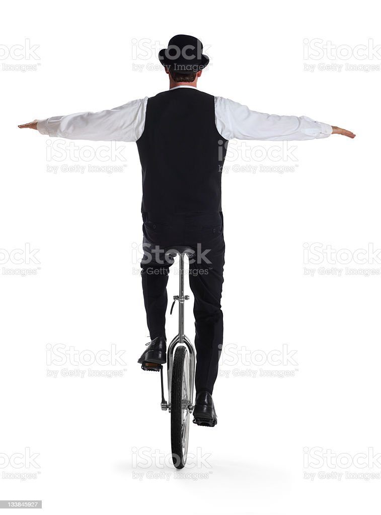 Business Man on a Unicycle Holding Arms out stock photo