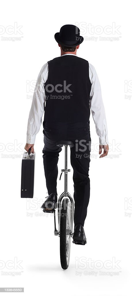 Business Man on a Unicycle Holding the briefcase royalty-free stock photo