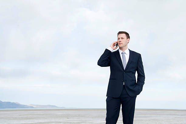 business man on cell phone stock photo