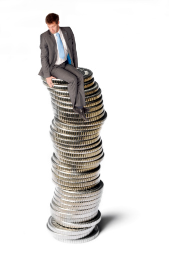 Business Man On Coins Stock Photo - Download Image Now
