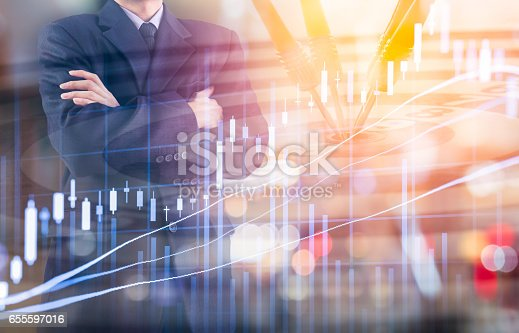 istock Business man on digital stock market financial and dart background. 655597016
