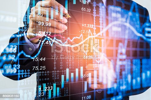 687520174istockphoto Business man on stock market financial trade indicator background. Man analysis stock market financial trade indices on LED. Double exposure of business man trade on stock market financial concept. 856805150