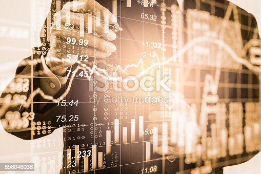 903982138istockphoto Business man on stock market financial trade indicator background. Man analysis stock market financial trade indices on LED. Double exposure of business man trade on stock market financial concept. 858046038