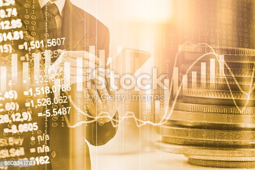 istock Business man on stock market financial trade indicator background. Man analysis stock market financial trade indices on LED. Double exposure of business man trade on stock market financial concept. 860334176