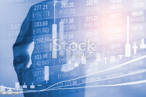 istock Business man on stock market financial trade indicator background. Man analysis stock market financial trade indices on LED. Double exposure of business man trade on stock market financial concept. 861087126