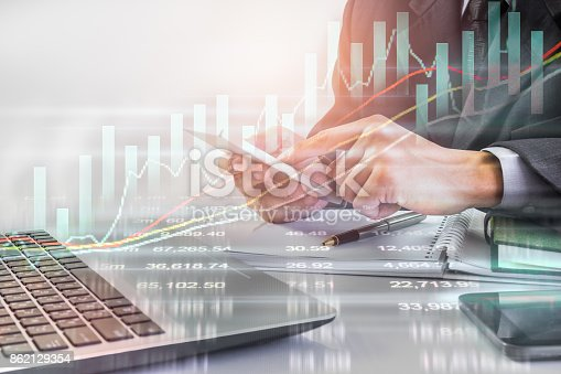 687520174istockphoto Business man on stock market financial trade indicator background. Man analysis stock market financial trade indices on LED. Double exposure of business man trade on stock market financial concept. 862129354