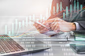 istock Business man on stock market financial trade indicator background. Man analysis stock market financial trade indices on LED. Double exposure of business man trade on stock market financial concept. 862129354