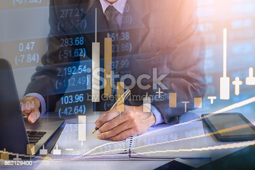istock Business man on stock market financial trade indicator background. Man analysis stock market financial trade indices on LED. Double exposure of business man trade on stock market financial concept. 862129400