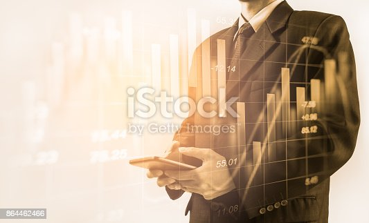 istock Business man on stock market financial trade indicator background. Man analysis stock market financial trade indices on LED. Double exposure of business man trade on stock market financial concept. 864462466