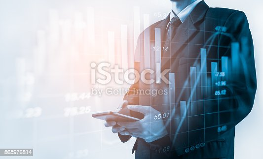 istock Business man on stock market financial trade indicator background. Man analysis stock market financial trade indices on LED. Double exposure of business man trade on stock market financial concept. 865976814