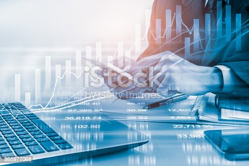 istock Business man on stock market financial trade indicator background. Man analysis stock market financial trade indices on LED. Double exposure of business man trade on stock market financial concept. 865977068