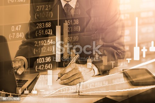 istock Business man on stock market financial trade indicator background. Man analysis stock market financial trade indices on LED. Double exposure of business man trade on stock market financial concept. 867212636