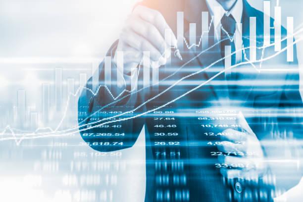 Business man on stock market financial trade indicator background. Man analysis stock market financial trade indices on LED. Double exposure of business man trade on stock market financial concept. stock photo