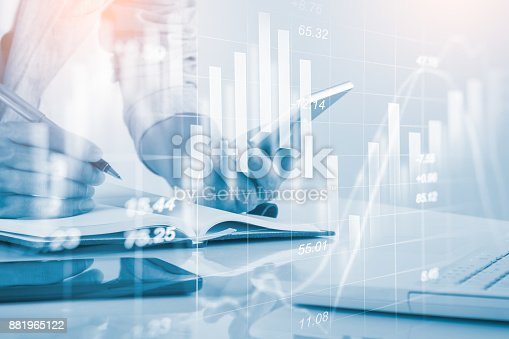 687520174istockphoto Business man on stock market financial trade indicator background. Man analysis stock market financial trade indices on LED. Double exposure of business man trade on stock market financial concept. 881965122