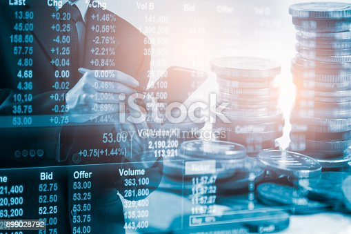 903982138istockphoto Business man on stock market financial trade indicator background. Man analysis stock market financial trade indices on LED. Double exposure of business man trade on stock market financial concept. 899028792