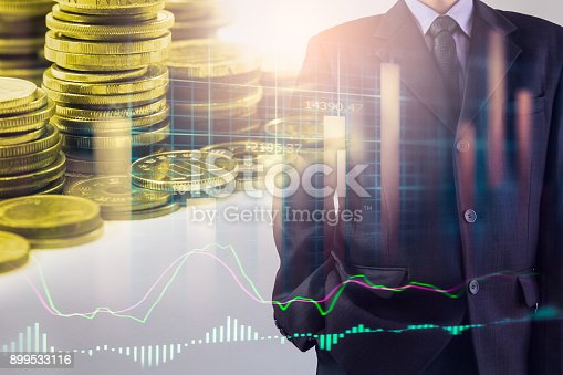istock Business man on stock market financial trade indicator background. Man analysis stock market financial trade indices on LED. Double exposure of business man trade on stock market financial concept. 899533116
