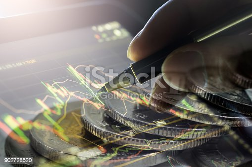 istock Business man on stock market financial trade indicator background. Man analysis stock market financial trade indices on LED. Double exposure of business man trade on stock market financial concept. 902728520