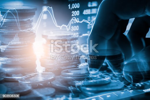 687520174istockphoto Business man on stock market financial trade indicator background. Man analysis stock market financial trade indices on LED. Double exposure of business man trade on stock market financial concept. 903506306