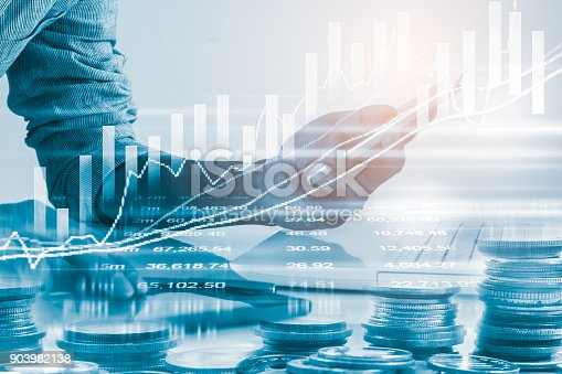 687520174istockphoto Business man on stock market financial trade indicator background. Man analysis stock market financial trade indices on LED. Double exposure of business man trade on stock market financial concept. 903982138