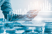 istock Business man on stock market financial trade indicator background. Man analysis stock market financial trade indices on LED. Double exposure of business man trade on stock market financial concept. 903982138