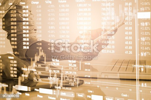 903982138istockphoto Business man on stock market financial trade indicator background. Man analysis stock market financial trade indices on LED. Double exposure of business man trade on stock market financial concept. 907909010