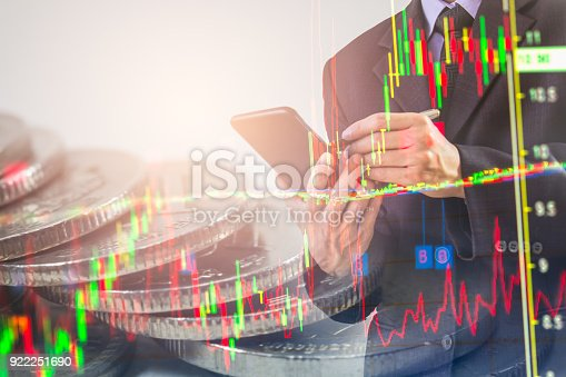 istock Business man on stock market financial trade indicator background. Man analysis stock market financial trade indices on LED. Double exposure of business man trade on stock market financial concept. 922251690