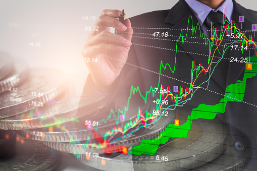 687520174 istock photo Business man on stock market financial trade indicator background. Man analysis stock market financial trade indices on LED. Double exposure of business man trade on stock market financial concept. 923559226