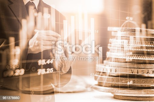 istock Business man on stock market financial trade indicator background. Man analysis stock market financial trade indices on LED. Double exposure of business man trade on stock market financial concept. 951378660