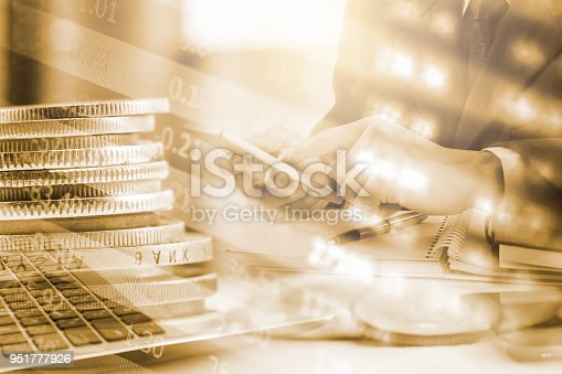 istock Business man on stock market financial trade indicator background. Man analysis stock market financial trade indices on LED. Double exposure of business man trade on stock market financial concept. 951777926