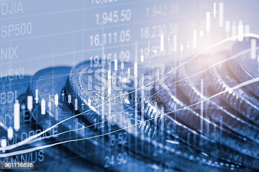 903982138istockphoto Business man on stock market financial trade indicator background. Man analysis stock market financial trade indices on LED. Double exposure of business man trade on stock market financial concept. 961116898