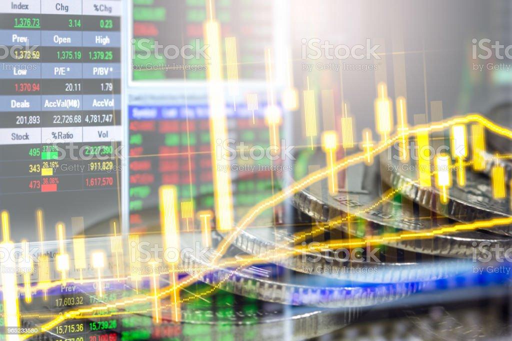 Business man on stock market financial trade indicator background. Man analysis stock market financial trade indices on LED. Double exposure of business man trade on stock market financial concept. zbiór zdjęć royalty-free
