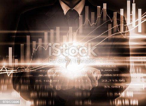 903982138istockphoto Business man on stock market financial trade indicator background. Man analysis stock market financial trade indices on LED. Double exposure of business man trade on stock market financial concept. 976423696