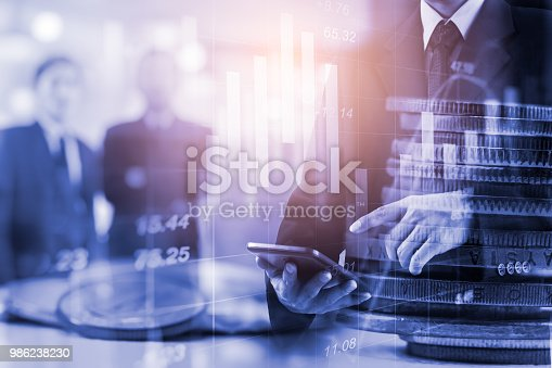 687520174istockphoto Business man on stock market financial trade indicator background. Man analysis stock market financial trade indices on LED. Double exposure of business man trade on stock market financial concept. 986238230